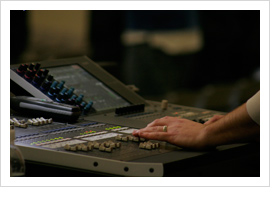 Hands on a Mixing console