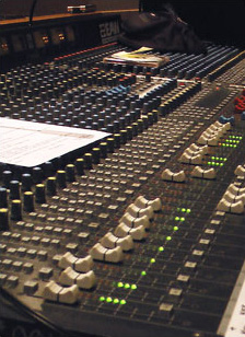 Large audio console in a recording studio