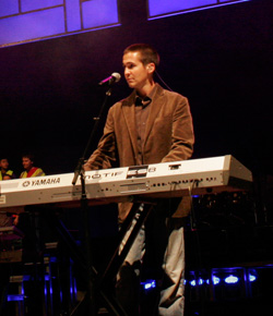 Male keyboard player at a keyboard on stage
