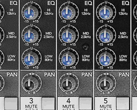 Close-up photo of EQ dials on a mixing board