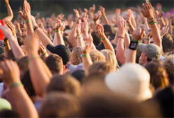 Music Lovers standing outdoors with their hands raised