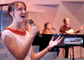 Female worship leader with handheld mic