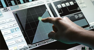 Close-up photo of a finger pointing and using the SSL console's touch screen